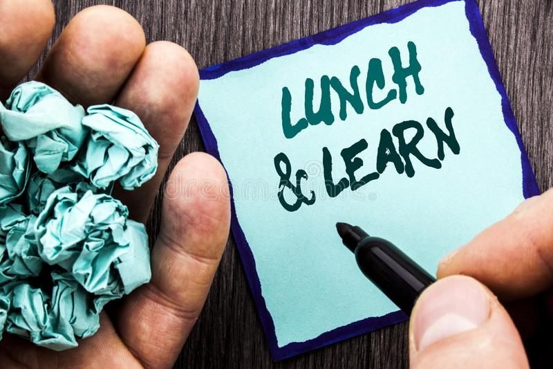 Announcement text showing Lunch And Learn. Business concept for Presentation Training Board Course written on Notebook Book Man Wr. Announcement text showing royalty free stock photo