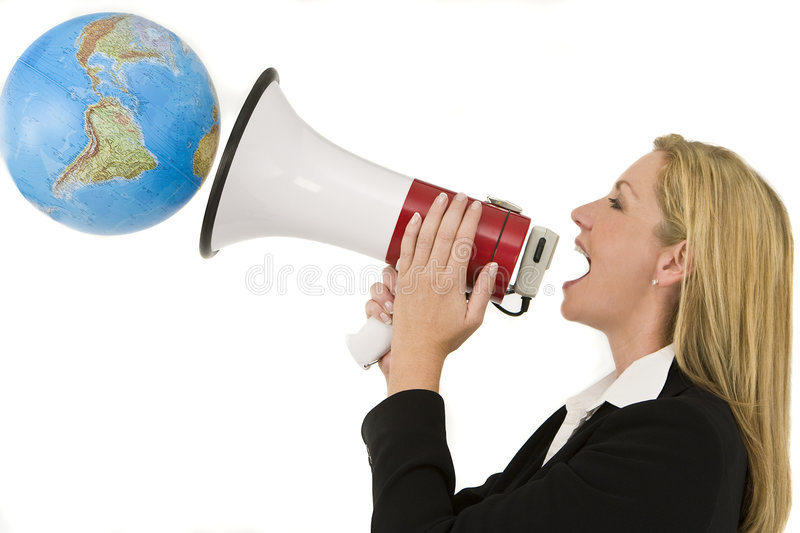 Announcing To The World. A businesswoman shouting at the world through a megaphone stock photo