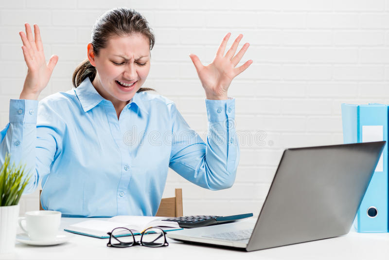 The annoyed accountant screams during the reporting period. And is nervous royalty free stock photos