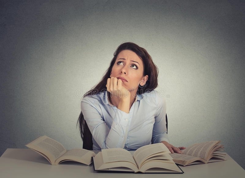Annoyed, bored, tired, woman, funny student sitting at desk royalty free stock photos