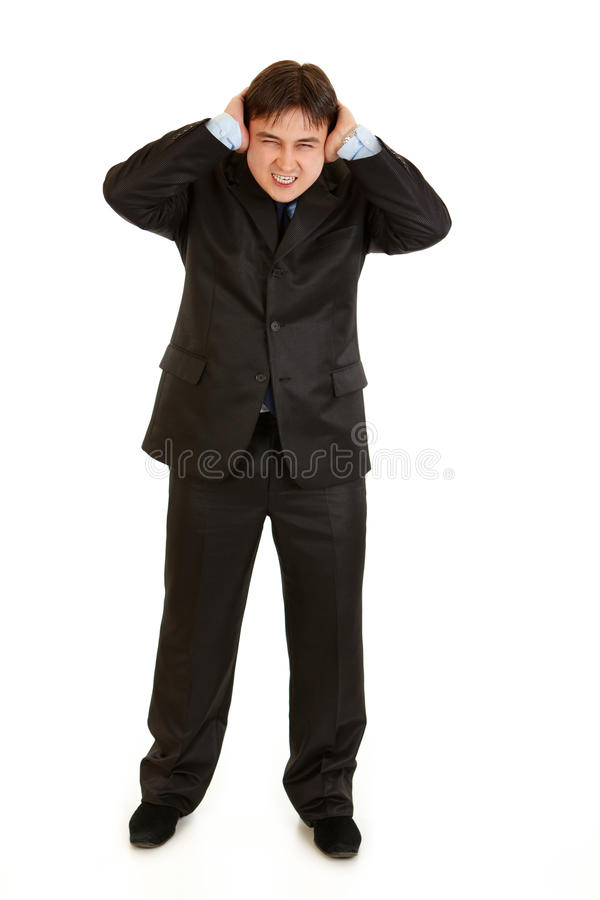 Download Annoyed Businessman  Closing Ears With Hands Stock Photo - Image: 18633738