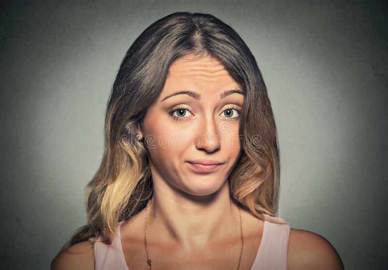 Annoyed displeased skeptical woman looking at you stock photography
