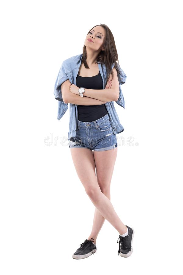 Annoyed dissatisfied young beautiful woman looking away with chin raised up. royalty free stock image