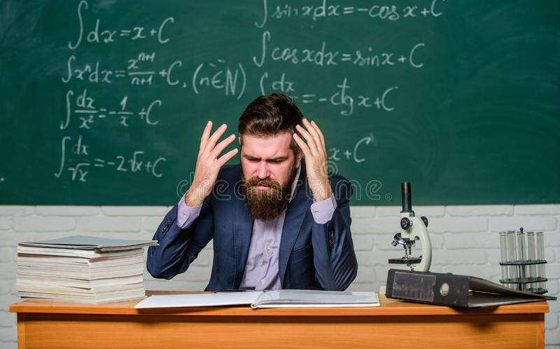 Annoyed and irritated. Annoyed man gestures and shouts in anger. Annoyed teacher checks examination papers. Annoyed. Negative emotions stock images