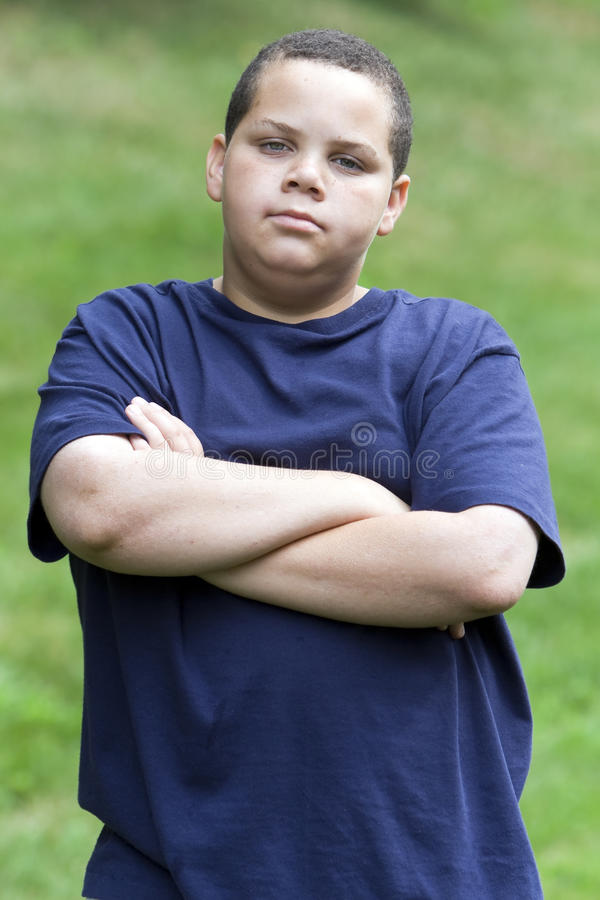 Download Annoyed teen stock photo. Image of stoic, mixed, child - 9725434