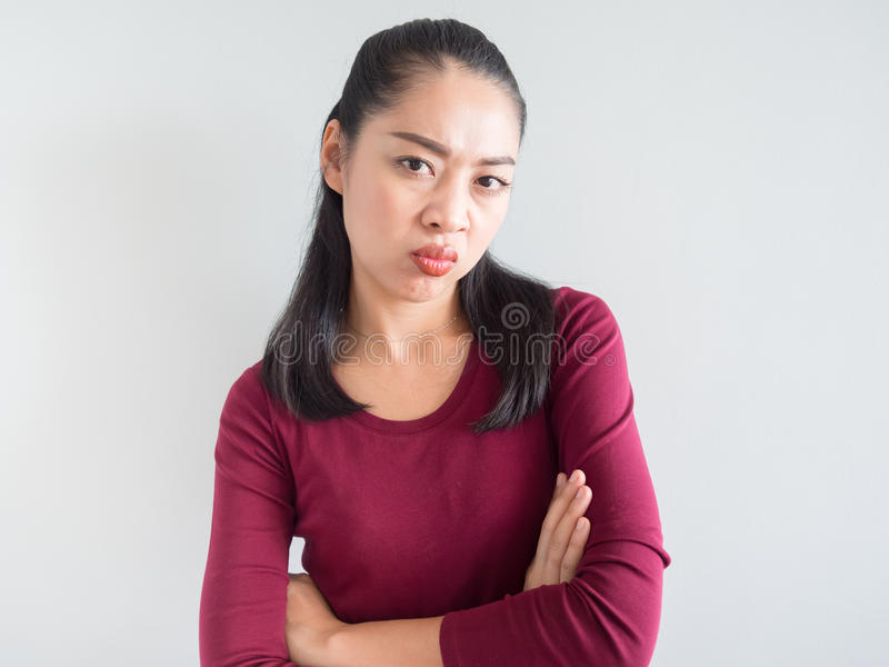 Annoyed and unhappy woman. royalty free stock photography