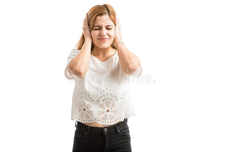 Annoyed woman covering ears royalty free stock photo