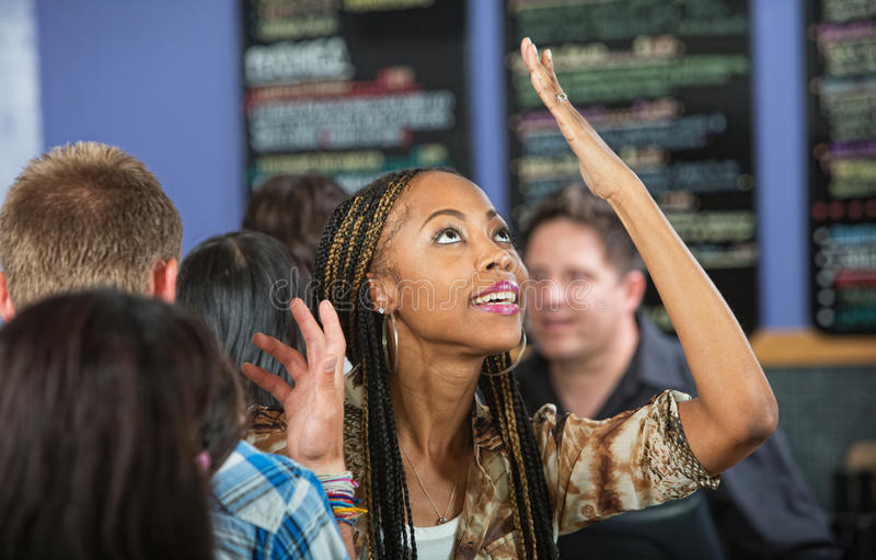 Annoyed Woman in Line. Annoyed Latina customer with hands on head at cafe stock photos