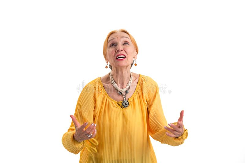 Annoyed woman looking up. stock images