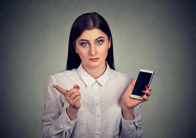 Annoyed woman upset with smartphone stock images