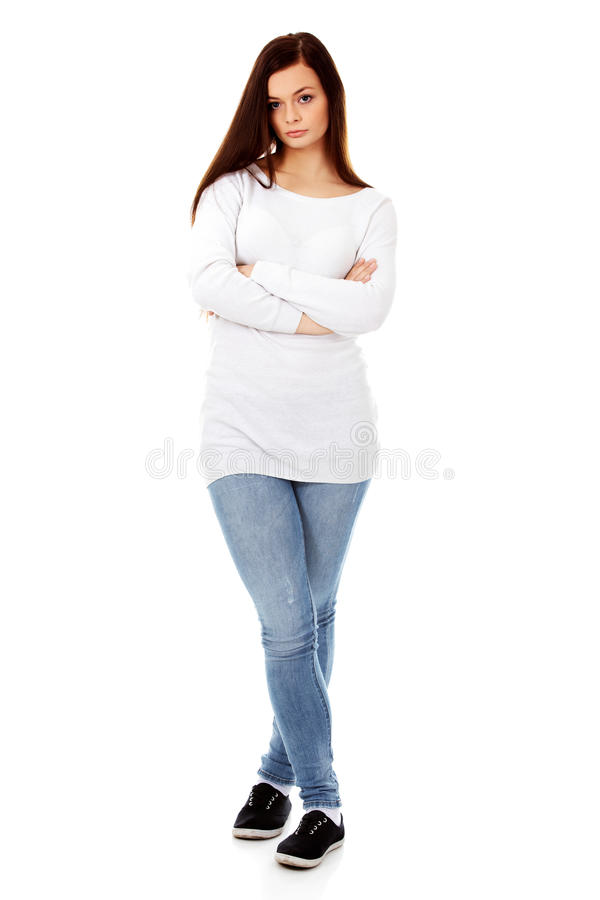 Annoyed young woman with arms crossed stock image