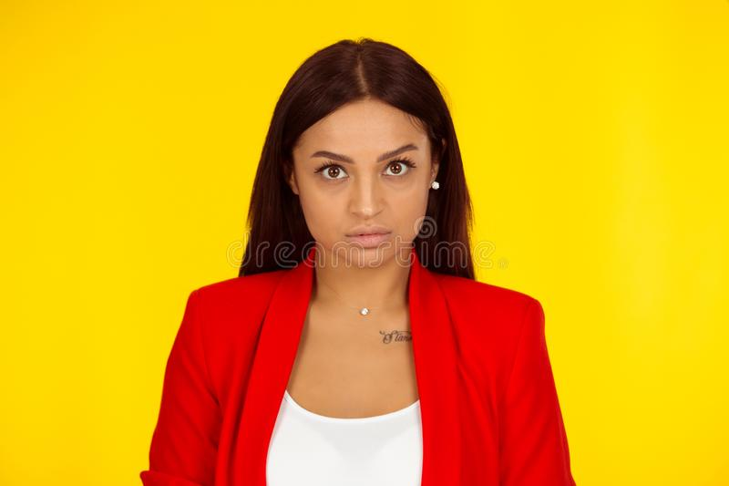 Annoyed young woman looking at camera mad royalty free stock images