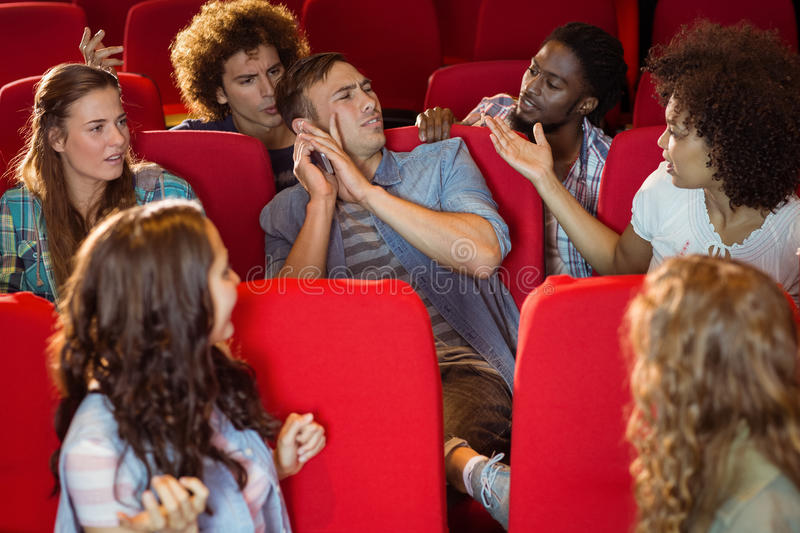 Annoying man on the phone during movie stock image