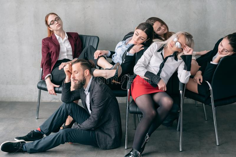 Annual audit overworking fatigue managers sleep. Annual audit. Overworking fatigue. Tired managers sleeping on chairs and floor royalty free stock images