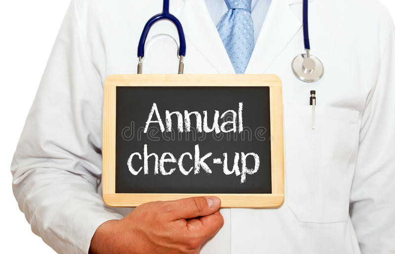 Annual check-up - doctor with chalkboard. On white background royalty free stock photo