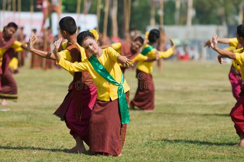 The Annual Elephant Roundup in Surin, Thailand. SURIN - NOVEMBER 21: Dancers in traditional farmer's outfits during The Annual Elephant Roundup on November 21 stock photos
