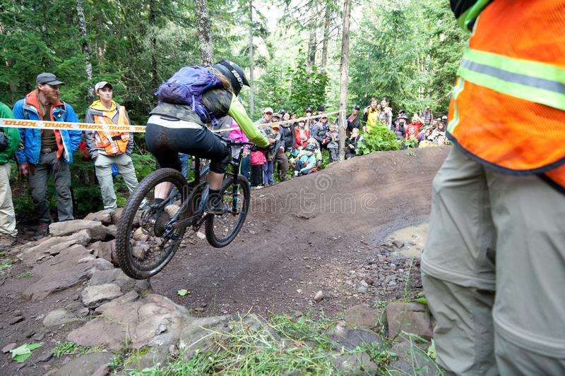 On 9/2/2017 in Copper Harbor, Michigan mountain biker launching from the ramp during enduro race royalty free stock photography