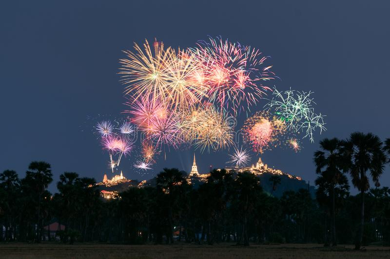 Annual festival of Khao Wang temple with colorful fireworks on hill at night. Phetchaburi, Thailand royalty free stock photography