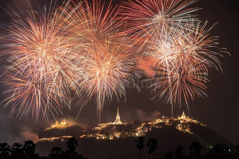 Annual festival of Khao Wang temple with colorful fireworks on hill at night stock photo
