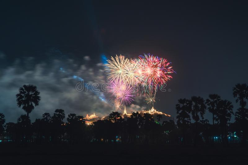 Annual festival of Khao Wang temple with colorful fireworks on hill at night royalty free stock photos
