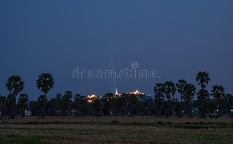 Annual festival of Khao Wang temple on hill in sugar plam plantation at dusk. Phetchaburi, Thailand royalty free stock image