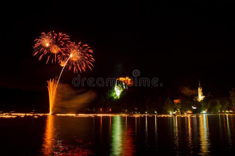 Annual midnight fireworks at lake Bled in orange royalty free stock image