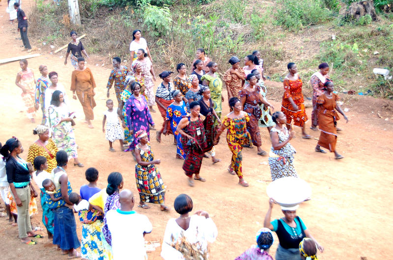 ANNUAL MYSTICAL DANCE. A village in Ivory Coast celebrating a feast to pay tribute to the divine forces in various ways through the annual dance of women in royalty free stock photos