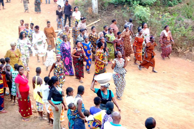 ANNUAL MYSTICAL DANCE. A village in Ivory Coast celebrating a feast to pay tribute to the divine forces in various ways through the annual dance of women in stock photo