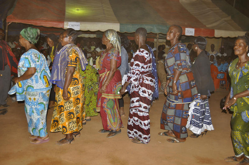 ANNUAL MYSTICAL DANCE. A village in Ivory Coast celebrating a feast to pay tribute to the divine forces in various ways through the annual dance of women in stock image