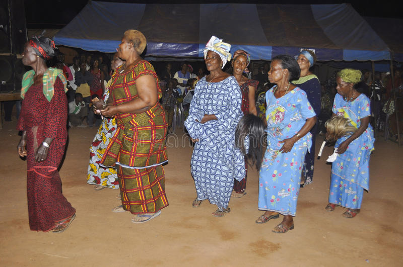 ANNUAL MYSTICAL DANCE. A village in Ivory Coast celebrating a feast to pay tribute to the divine forces in various ways through the annual dance of women in royalty free stock images