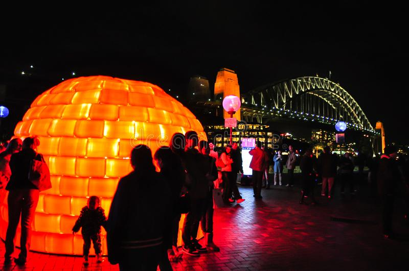 An annual outdoor lighting festival with Orange eskimo house immersive light installations and projections `Vivid Sydney` royalty free stock image