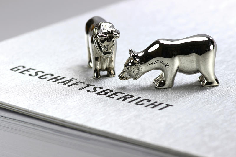 Annual report. German annual report with bull and bear figures royalty free stock photos