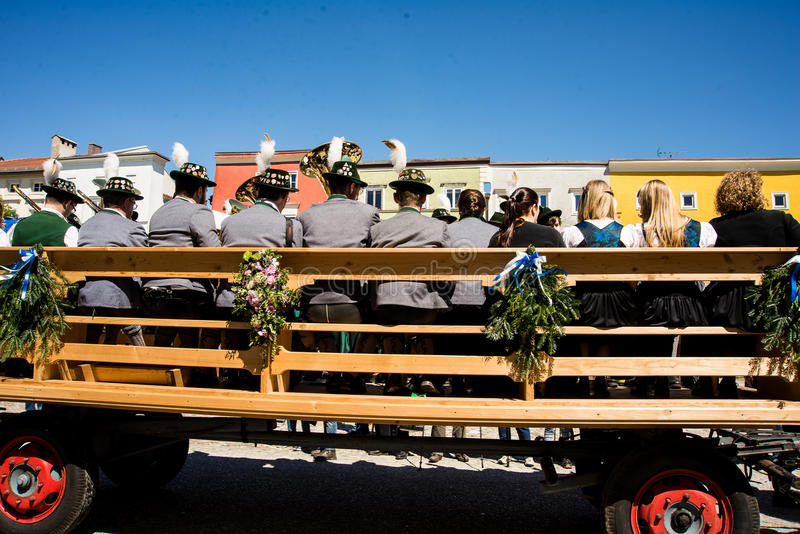 Annual St.George`s parade. A carriage with a bavarian brass band drives by at the Annual St.George`s parade royalty free stock photography