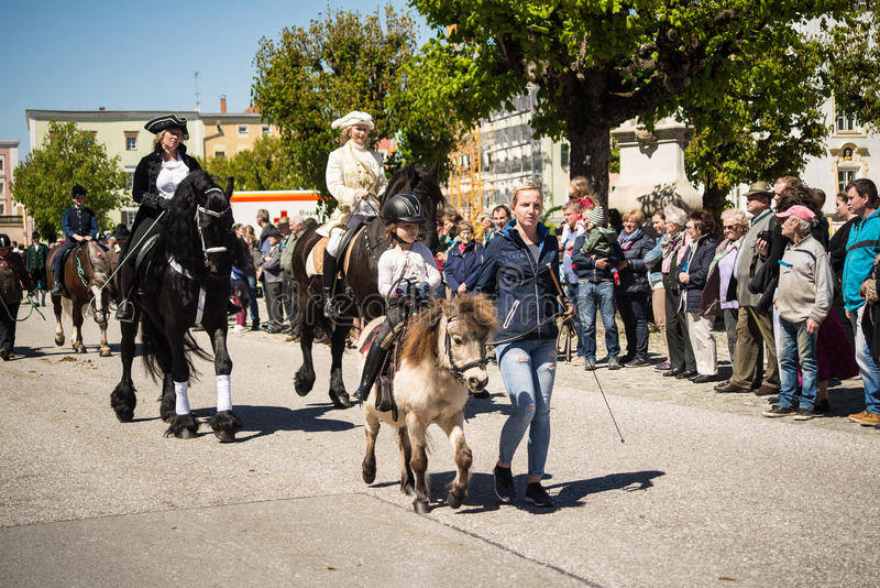 Annual St.George`s parade. A little girl rides a pony at the annual St.George`s parade royalty free stock photo