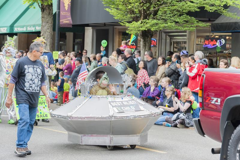 Annual UFO Festival in McMinnville Oregon. McMinnville, Oregon, USA - May 16, 2015: Alien child rides in his spaceship in the parade of the annual UFO Festival stock photo