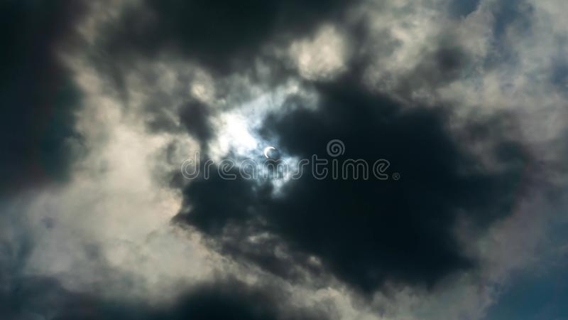 The annular `Ring of Fire` partial solar eclipse on the dark sky. The view of Solar Eclipse 2019 from Kuala Lumpur, Malaysia. The annular `Ring of Fire` partial royalty free stock photo