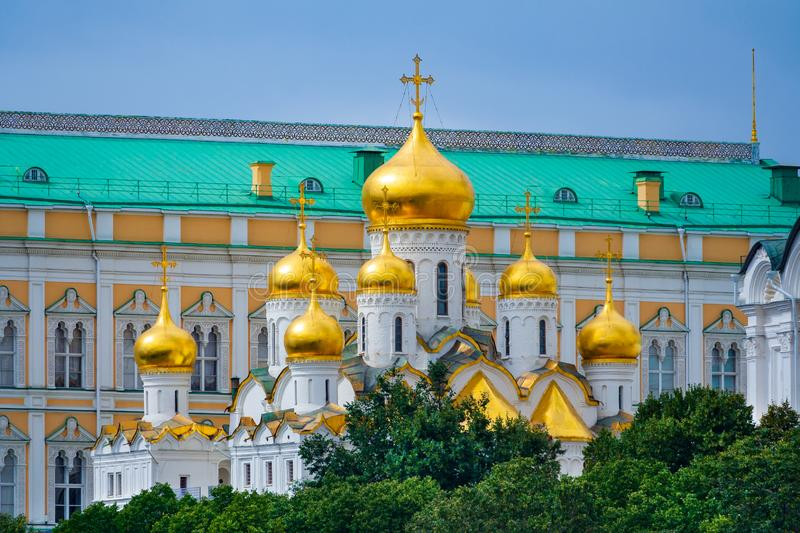 Annunciation Cathedral of the Moscow Kremlin with golden domes on a background of The Grand Kremlin Palace royalty free stock image