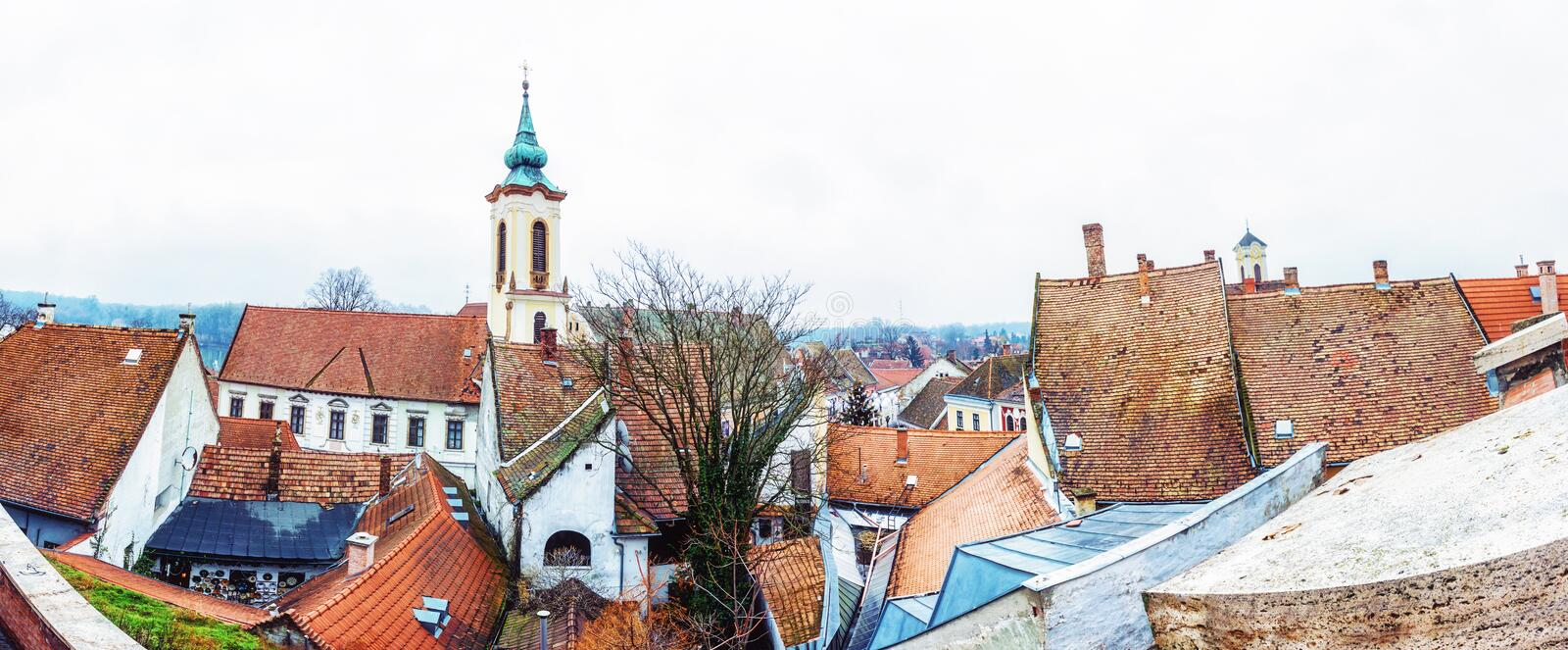 Annunciation church and red roofs of houses, Szentendre, Hungary. Annunciation church and red roofs of old houses, Szentendre, Hungary. Religious architecture stock photography