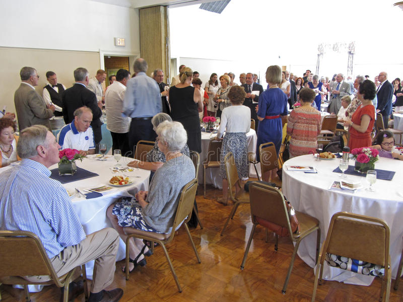 Annunciation Church Social. Photo of people enjoying food at a church social at annunciation catholic church in washington dc on 8/31/14. A new priest has been stock photos