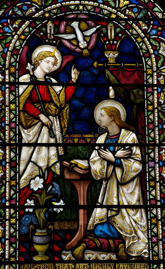 The Annunciation in stained glass. A photo of The Annunciation in stained glass stock photos