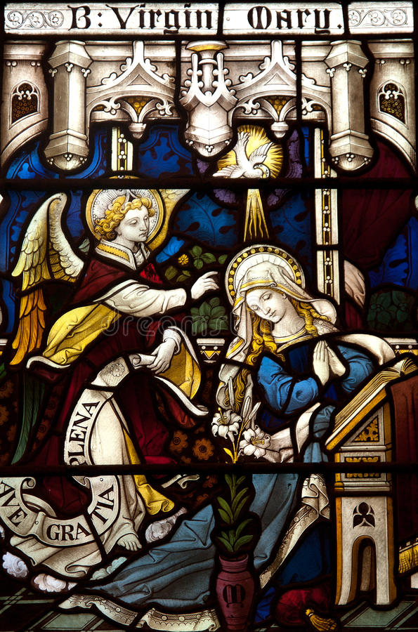 Annunciation in stained glass. Stained glass window of the annunciation stock photography