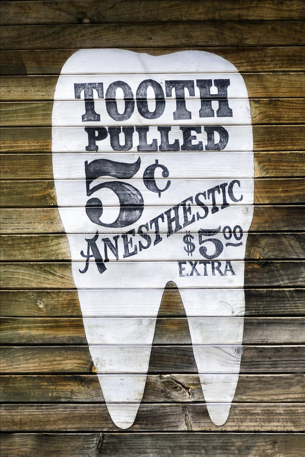 Annuncio divertente dell'estrazione del dente fotografia stock