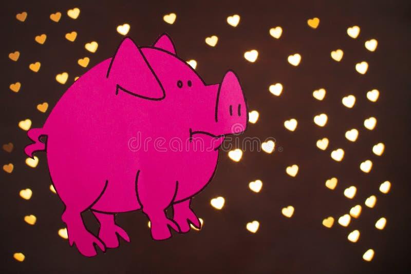 Ano chinês do sinal do zodíaco de porco, porco do corte do papel do rosa, ano novo feliz 2019 anos no fundo preto com bokeh bonit fotografia de stock