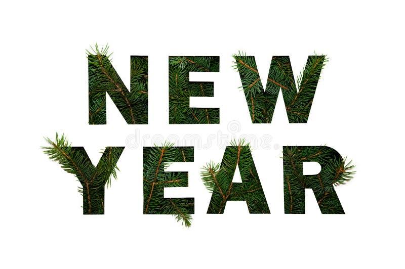 Ano novo das palavras com ramos verdes do abeto no fundo claro Conceito criativo da natureza Configuração mínima do plano fotos de stock