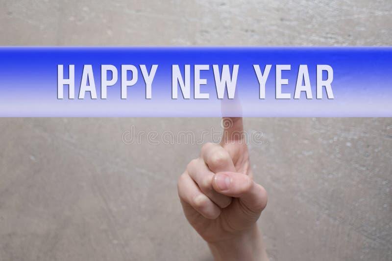 Ano novo feliz - dedo que pressiona o botão virtual azul imagens de stock royalty free