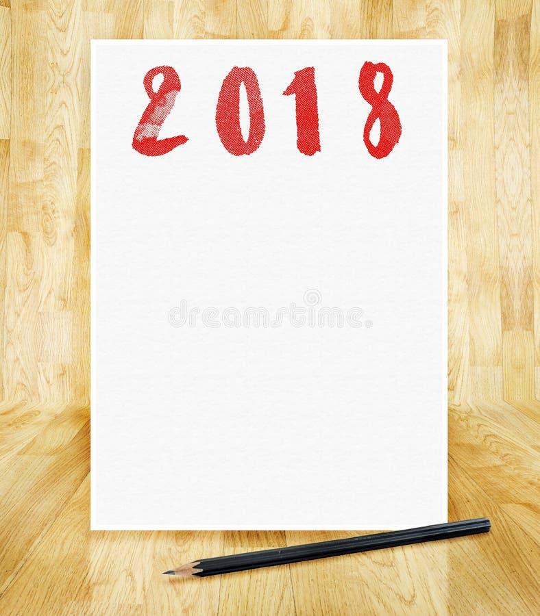 Ano novo feliz 2018 no quadro do Livro Branco com o bru do lápis à disposição fotos de stock