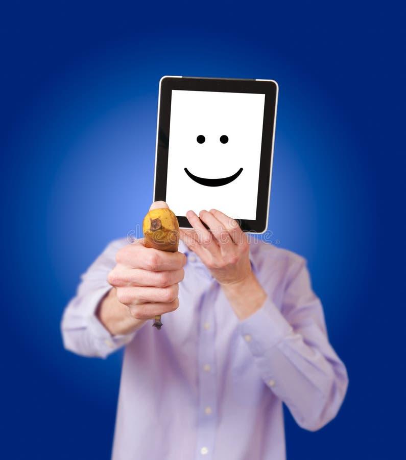 Anonieme rover met banaan stock afbeelding