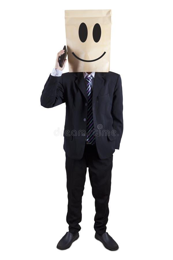 Anonymer Geschäftsmann, der am Telefon spricht stockfotografie