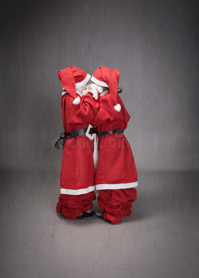 Anonymous children like little santa claus helper stock image