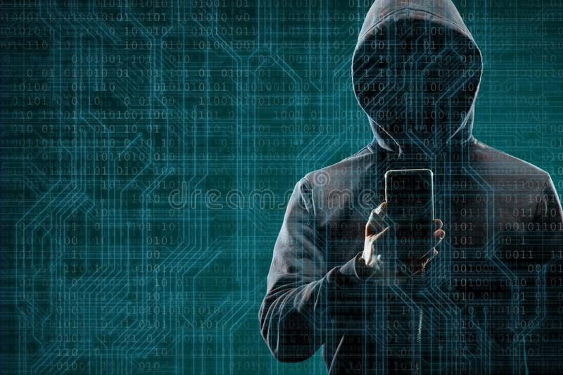 Anonymous computer hacker with a smartphone over abstract digital background. Obscured dark face in mask and hood. Data. Thief, internet attack, darknet fraud royalty free stock photos